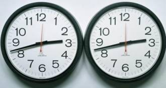 Two clocks, side by side, showing the same time